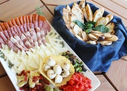 deli meats, cheeses and bread platters by Flavors Catering